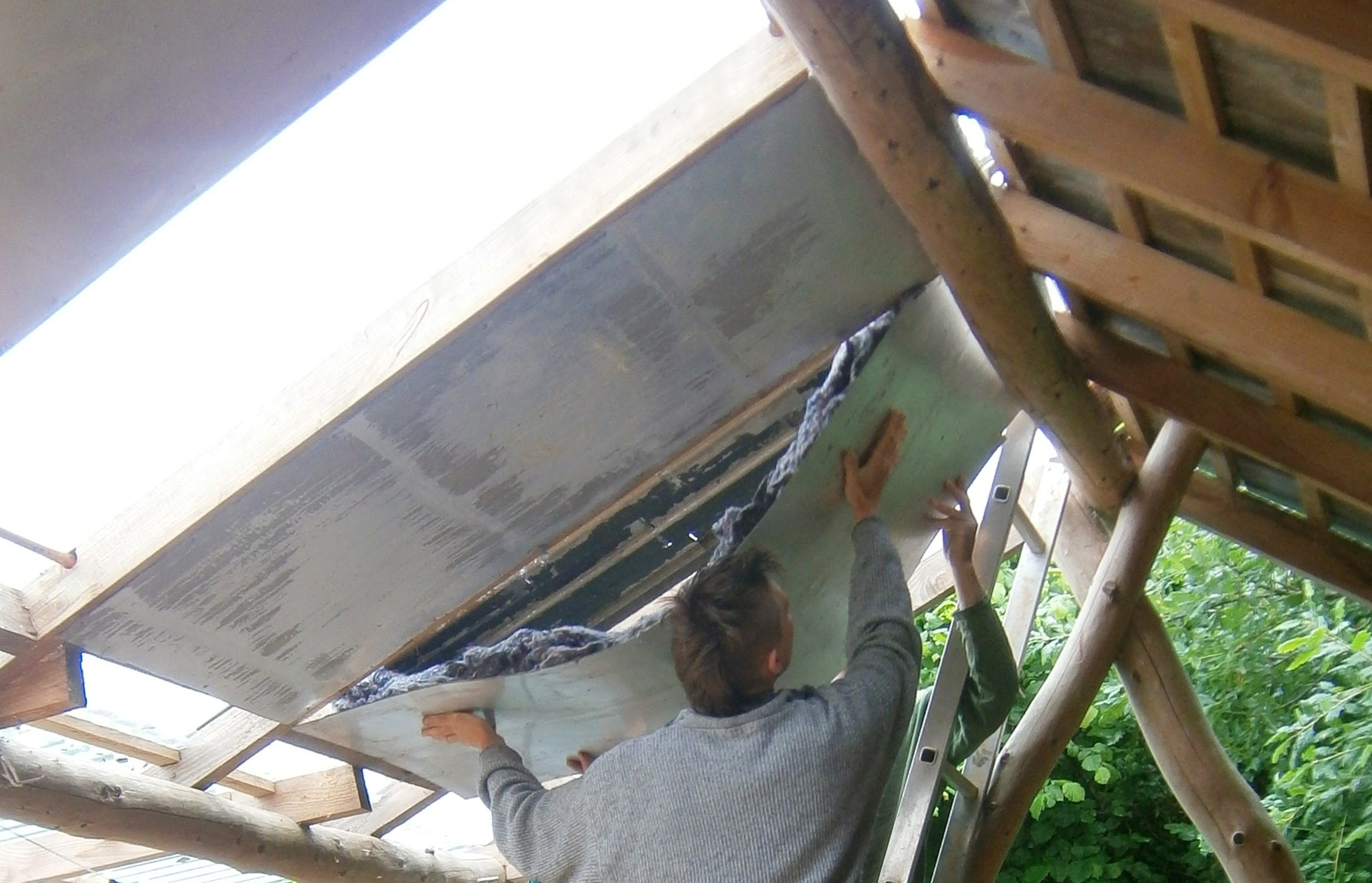 tim installing the backing to a panel.