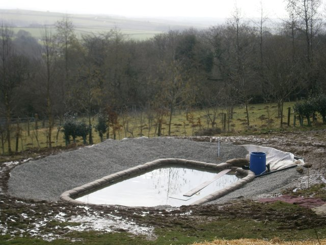 Natural swimming pond in construction